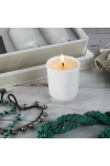Lit candle in a Transparent White Oxford Votive