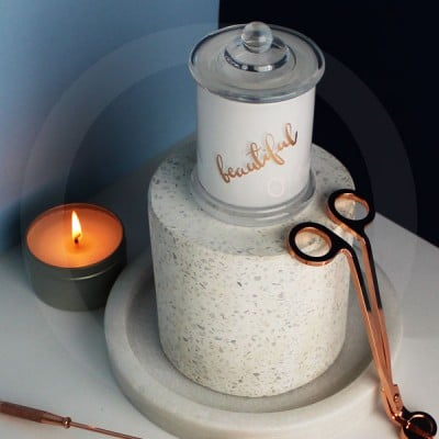 Lidded Danube base with gold foiling, wick trimmer and lit candle tin