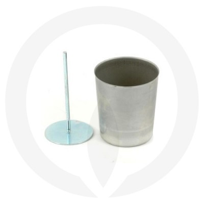 Votive Wick Pin shown next to a candle mould