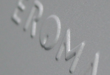 Eroma embossed metal lid closeup