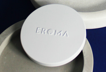 White metal lid with Eroma brand name embossed