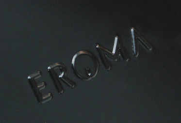 Eroma brand name embossed onto a black metal lid