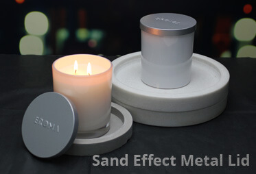 Candles with sand effect metal lids